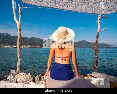 Young tourist woman in bathing suit in Thassos, Greece - Stock Image
