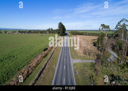 Road moved 4 metres sideways across faultline after earthquake, 4th September 2010, near Darfield, Canterbury, South Island, New Zealand - aerial - Stock Image