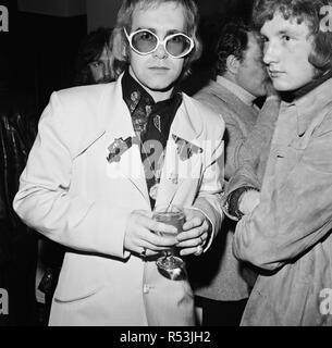 Photo shows Elton John.  Opening night party at the Old Barn for Joseph and The Amazing Technicolour Dreamcoat.  Written by Andrew Lloyd Webber and Tim Rice.  In February 1973, theatre producer Michael White and impresario Robert Stigwood mounted the Young Vic production at the Albery Theatre in the West End, where it ran for 243 performances  The story is based on the 'coat of many colours' story of Joseph from the Bible's Book of Genesis. This was the first Lloyd Webber and Rice musical to be performed publicly (the first, The Likes of Us, written in 1965, was not performed until 2005).  Pic - Stock Image