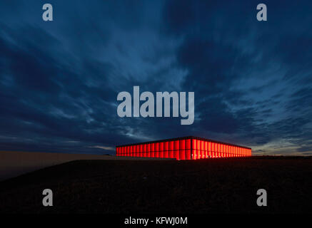 Night elevation with illumination in red. Carmen Würth Forum, Künzelsau-Gaisbach, Germany. Architect: - Stock Image