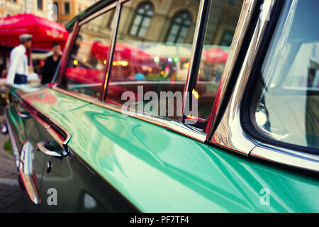 Evening city lights in glasses vintage car, Riga, Latvia - Stock Image