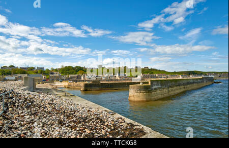 PORTGORDON MORAY SCOTLAND THE HARBOUR AND JETTIES ONE COVERED BY SHINGLE DUE TO WAVE ACTION - Stock Image