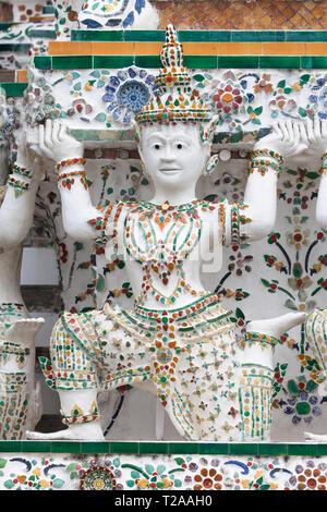 Caryatid supporting a Prang at Wat Arun, Bangkok, Thailand. - Stock Image