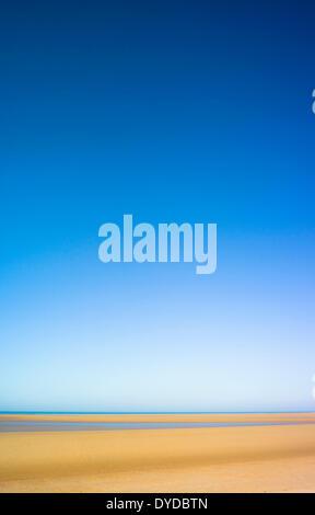 A deserted Norfolk beach. - Stock Image