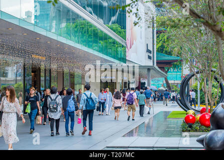 Shoppers, office workers and tourists walking along Scotts Road in central Singapore - Stock Image