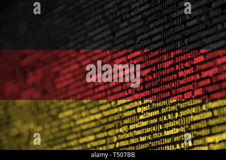 Germany flag  is depicted on the screen with the program code. The concept of modern technology and site development. - Stock Image