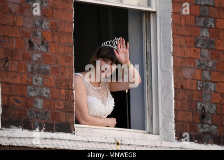 Royal Wedding of Prince Harry and Meghan Markle at Windsor. A 'princess' waves from a window in Windsor High Street - Stock Image