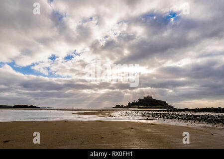 Sunshine over beach and St Michael's Mount, Cornwall, UK - Stock Image