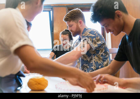 People doing string art craft - Stock Image
