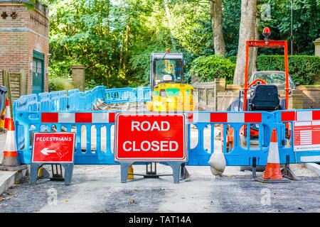 Street barricaded with ROAD CLOSED signs due to road maintenance - Stock Image
