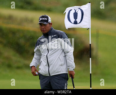 Portrush, County Antrim, Northern Ireland. 17th July 2019. The 148th Open Golf Championship, Royal Portrush Golf Club, Practice day ; Hideki Matsuyama (JAP) watches his ball as he practices his putting on the 13th green Credit: Action Plus Sports Images/Alamy Live News - Stock Image