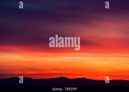 Red evening sky at sunset, behind the Palatinate Mountains, Dossenheim, Baden-Wurttemberg, Germany - Stock Image