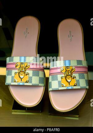 flip flops - Shop Window Louis Vuitton Florence Italy ( Louis Vuitton French Fashion House Paris France  ) - Stock Image