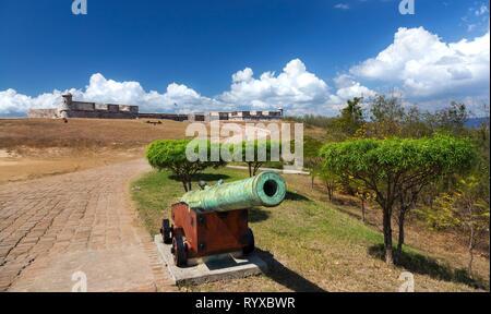 Old Cannon in front of San Pedro de la Roca Castle (Castillo Del Morro) Fortress on Santiago de Cuba Coast, a World Unesco Heritage Site - Stock Image