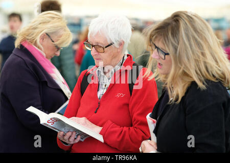 Hay Festival, Hay on Wye, Powys, Wales, UK - Friday 31st May 2019 - A visitor to the Festival bookshop takes a look at the new book by author Albert Woodfox.   Photo Steven May / Alamy Live News - Stock Image