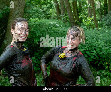 Mud runners posing hands on hips - Stock Image