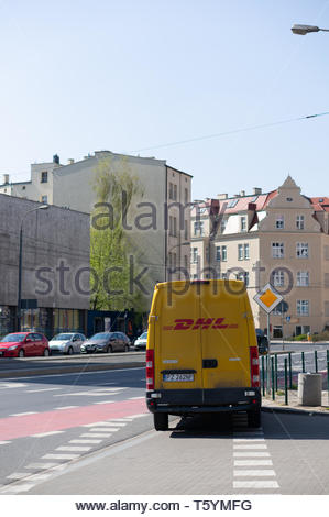 Poznan, Poland - April 18, 2019: DHL company delivery van parked by a road in the city center. - Stock Image