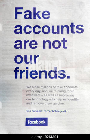 Face book advert 'Fake accounts are not our friends' in the Guardian newspaper London UK 12 April 2018 - Stock Image
