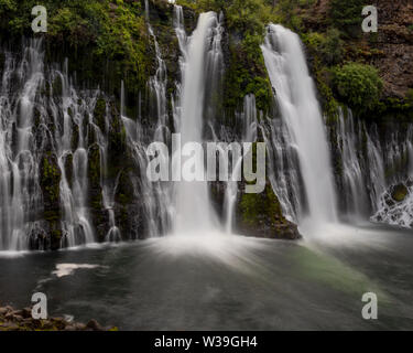 Overview of Macarthur-Burney falls wide angle view and long exposure on a spring day - Stock Image