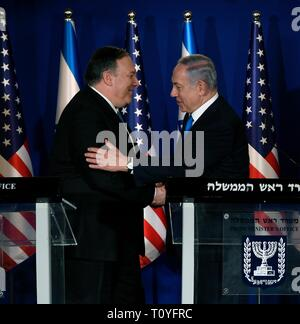 U.S. Secretary of State Mike Pompeo, left, is embraced by Israeli Prime Minister Benjamin Netanyahu during a joint press conference at the official residence March 21, 2019 in Jerusalem, Israel. - Stock Image