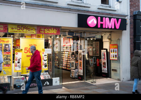 Pedestrians walk past HMV which has entered administration for the second time - Stock Image