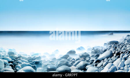 Water and Rolling Stones - Stock Image
