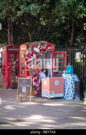 Ice Cream stall in an old red telephone box, London, UK - Stock Image