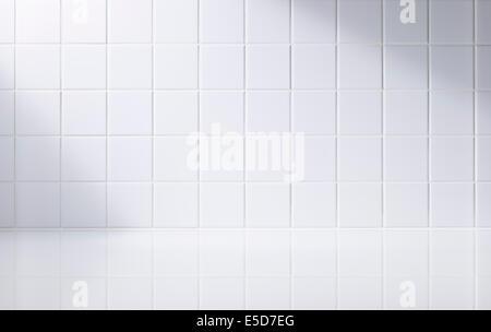 A white tiled bathroom - Stock Image
