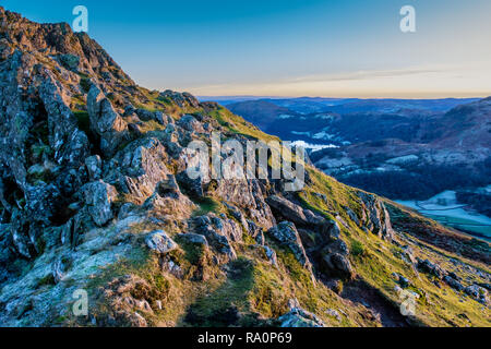 Grasmere and Loughrigg, seen from the summit of Helm Crag, Grasmere, Lake District, Cumbria - Stock Image