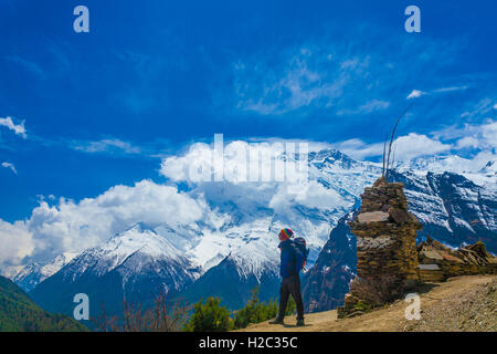 Photo Man Traveler Backpacker Mountains Way.Young Guy Looking Away Take Rest Sunny Terrace Path.Snow Landscape Background. - Stock Image