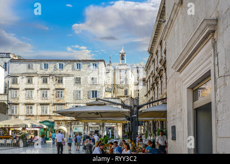 People's Square inside Diocletian's Palace in the ancient city of Split Croatia, with tourists, cafes and the bell tower in the distance - Stock Image