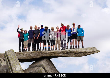 A large group of hikers standing on the cantilever rock on Glyder Fach mountain in Snowdonia National Park. Ogwen, Conwy, Wales, UK, Britain - Stock Image
