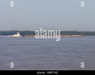 A towboat and barge moving goods on the Mississippi River - Stock Image