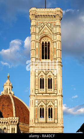 Florence, Italy. The Campanile (bell tower), designed by Giotto and built between 1334 and 1359, in evening light - Stock Image