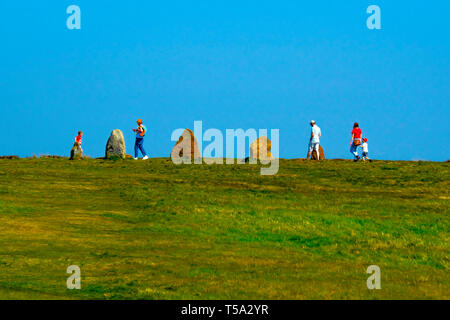 Young families exploring  standing stones on the North Yorkshire Moors near Lord Stones Café Carlton in Cleveland Chop Gate Yorkshire England UK - Stock Image