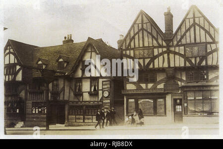 Ye Olde Chequers Inn (left), Tonbridge, Kent, with Dance's Umbrella Stores on the right. - Stock Image