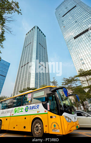 Electric City-Bus (E-Bus) on a street of Shenzhen. Guangdong Province, China. - Stock Image