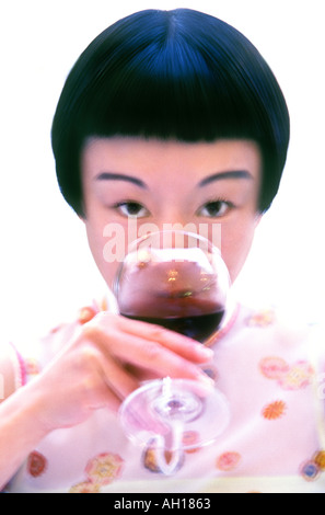 Young asian woman tasting wine - Stock Image