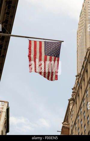 USA flag hanging on a financial building in Wall Street, NY, New York, USA - Stock Image