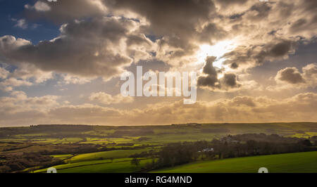 Wareham, Dorset. 27th January 2019. A dramatic sunset over the English countryside in rural Dorset. UK weather. Credit: Thomas Faull/Alamy Live News - Stock Image