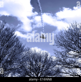 Small airplane in the sky - Stock Image