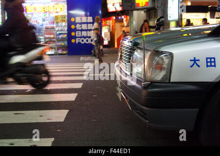 Close up front of silver taxi side angle - Stock Image