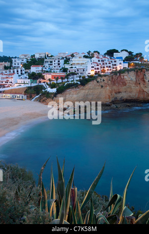 Portugal, Algarve, Carvoeiro, Beach & Town at Dusk - Stock Image