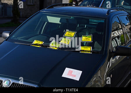 Detail of illegally parked car on double-yellow lines with six penalty charge notices. Parkside Road, Kendal, Cumbria, England, United Kingdom, Europe - Stock Image