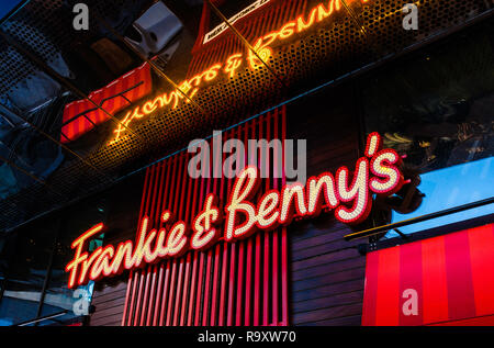 Sign for a Frankie and Benny's restaurant. - Stock Image