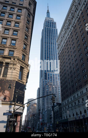December 2017 The Empire State Building as seen from the road level, at 6th Avenue, New York City, New York - Stock Image