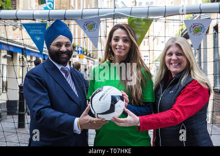 London, UK. 18th March, 2019. Ranjit Baxi, Founding President of the Global Recycling Foundation, Taekwondo World Champion Samira El Idrissi and Susie Burrage, President of British Metals Recycling Association, prepare to take part in the Recycling Goals football challenge to mark the celebration of the second annual Global Recycling Day. The challenge is a social media movement that harnesses the power of football to inspire long term recycling habits in young people across the world. Credit: Mark Kerrison/Alamy Live News - Stock Image
