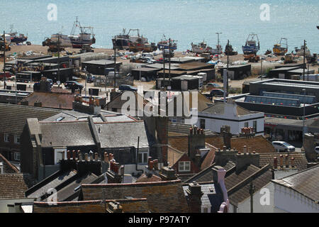 Hastings, UK -July 14 2018: General view of the seaside town of the fishing port of Hastings from the West Hill on a hot summers day as the temperatures sore to above 27 degrees on 14 July 2018.  Hastings on the south coast of England is 53 miles south-east of London and is 8 miles from where the  Battle of Hastings took place in October 1066. Credit: David Mbiyu Credit: david mbiyu/Alamy Live News - Stock Image