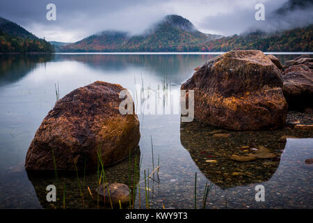 Low clouds settle in around The Bubbles on Jordan Pond in Acadia National Park. - Stock Image