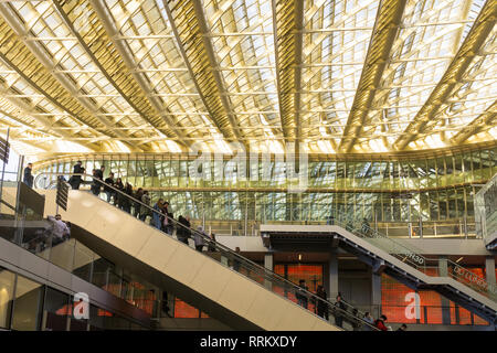 People riding escalators at Forum des Halles mall in Les Halles area of Paris, France. - Stock Image